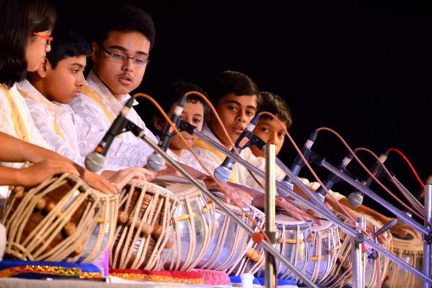 Children's group tabla recital at the event.