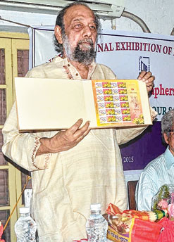 Artist Nikhilesh Das launches a postal stamp with the SOP logo. Picture by Gopal Senapati