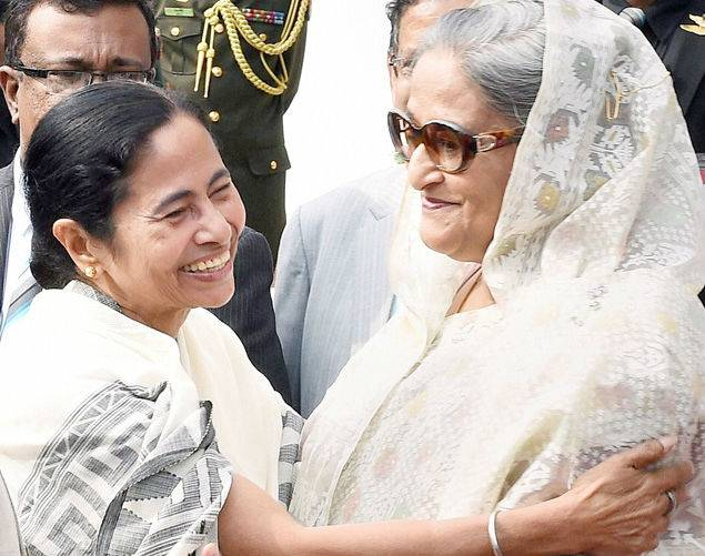 Bangladeshi Prime Minister Sheikh Hasina and West Bengal chief minister Mamata Banerjee hug each other at the flag-off ceremony of bus services between Bangladesh and India, in Dhaka on Saturday. (PTI Photo)