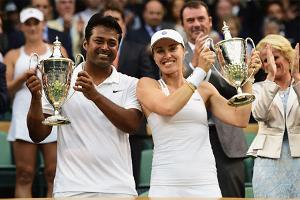 Leander Paes with his Swiss partner Martina Hingis won the mixed doubles title at Wimbledon. (Getty Image)