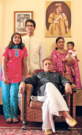 REGAL ROOTS: Shahebzade Wasif Mirza and his family pose before the portrait of Nawab Wajid Ali Shah;