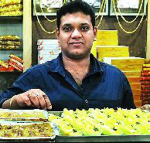 Sudip Mullick displays some of the innovative sweets at his shop.