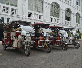 Battery-powered rickshaws wait for passengers in the Fort William campus in Kolkata.— Photo: Special Arrangement