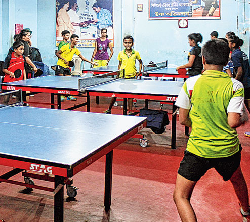 Children practise table tennis at Siliguri Table Tennis Academy on Friday. Picture by Passang Yolmo